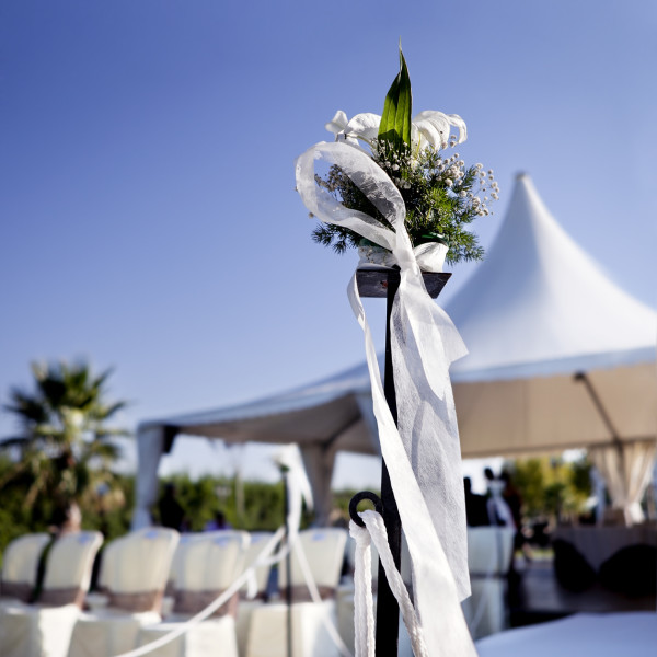 Beautiful ceremony venue with flowers and blue sky.Outdoor ceremony